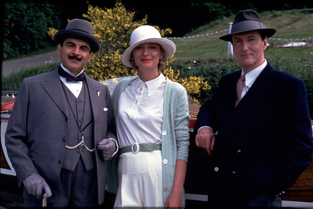 Agatha Christie's Poirot [6] Episode 4 - Dumb Witness Mystical premonitions, family inheritance and suspicious murders ruin Poirot's plans to go and watch a friend of Hastings' attempt to break the world water speed record. The Tripp sisters' supernatural warnings and Poirot's advice to change her will, fail to prevent the murder of Emily Arundel. Poirot must reflect on which member of the family poisoned the medicine. Bob, the terrier dog, is the only one who knows who the murderer really is. L-R: DAVID SUCHET as Poirot,m KATE BUFFERY as Theresa Arundel and HUGH FRASER as Captain Hastings © ITV plc (Granada International)